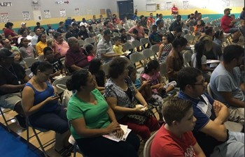 Parents listening to speakers at WatchDog Event