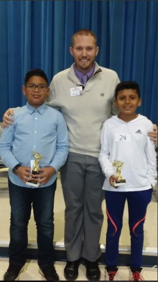 Spelling bee winners with Mr. Tuft, principal