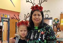 Mrs. Shales and student dressed similar