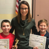 Principal Evans with the Spelling Bee Winner and Runner-up