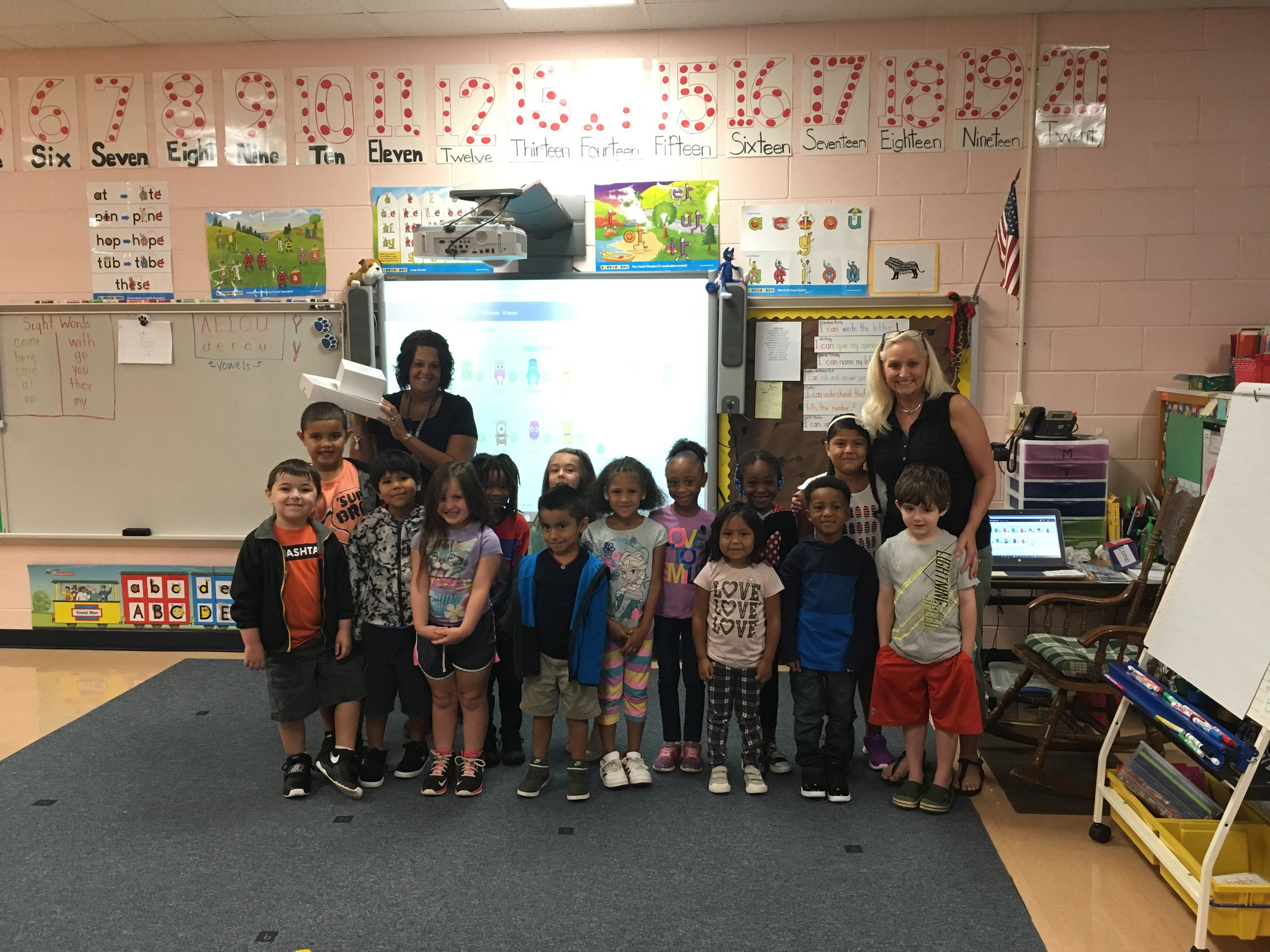 Mrs. Beck's Kindergarten Class Celebrating with Donuts for 100% in Class Dojo