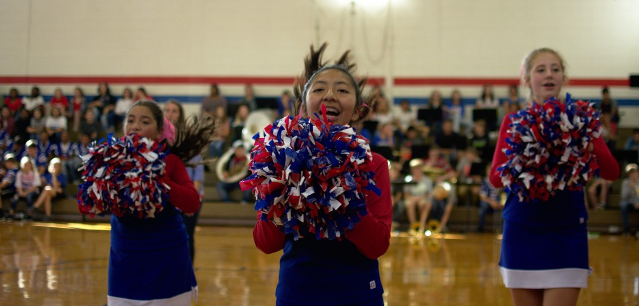 Cheerleaders perform a cheer during the pep rally.