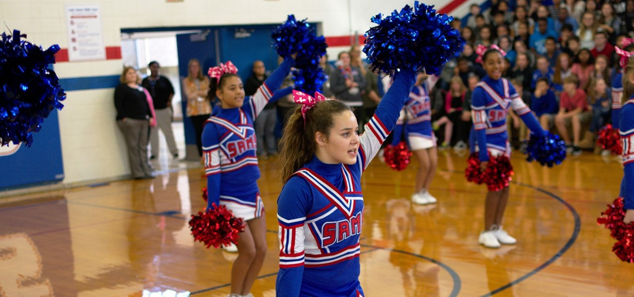 Cheerleaders perform during a pep rally