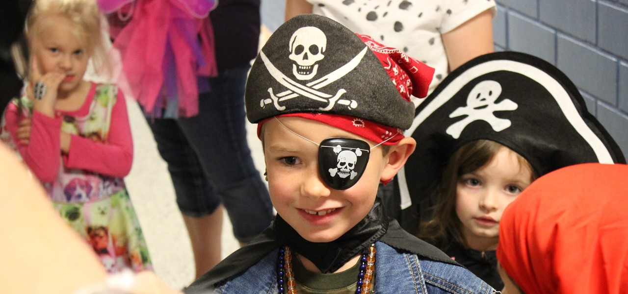 Kindergarten student dressed as a pirate for the Book Fair family reading night costume event.
