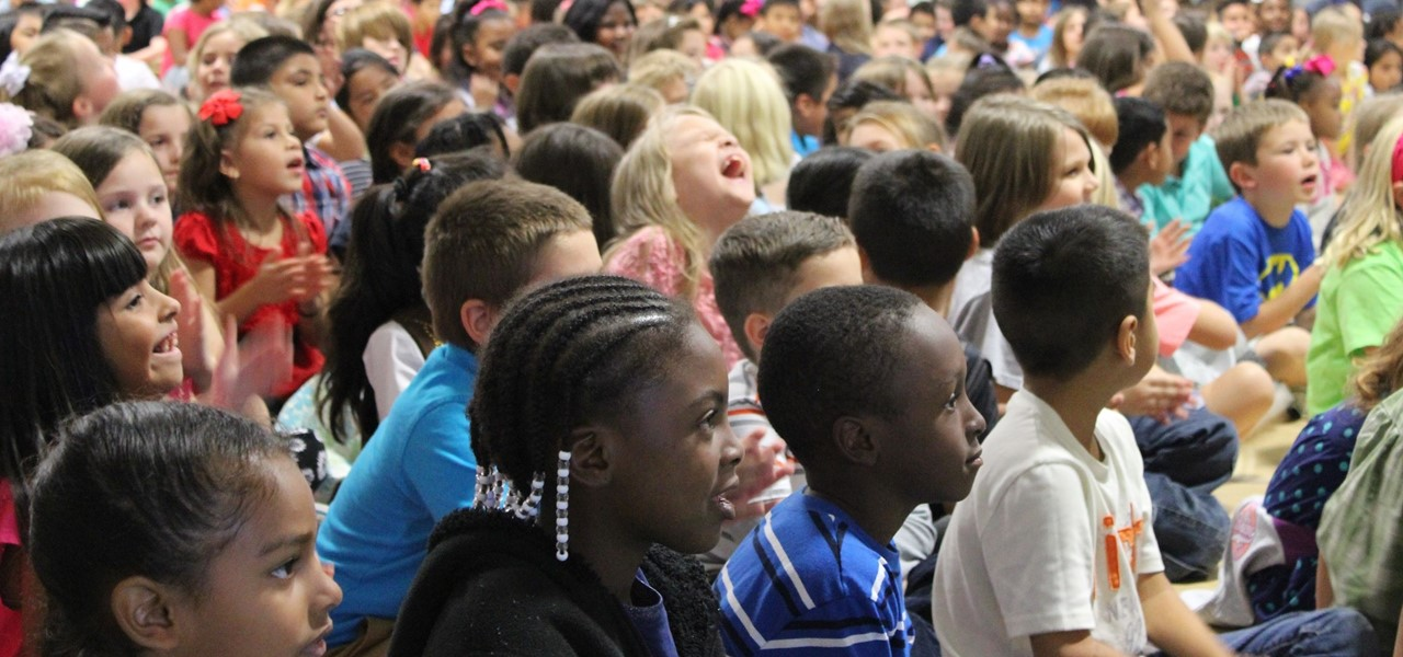 First grade students enjoy the beginning-of-the-year, whole-school reading kick-off assembly