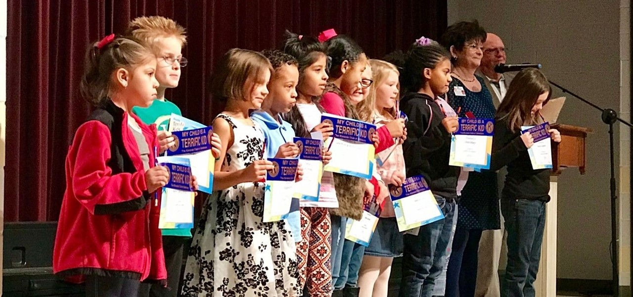 "Second and third grade students receive ""Terrific Kid"" awards at a recent Academic Awards Day"