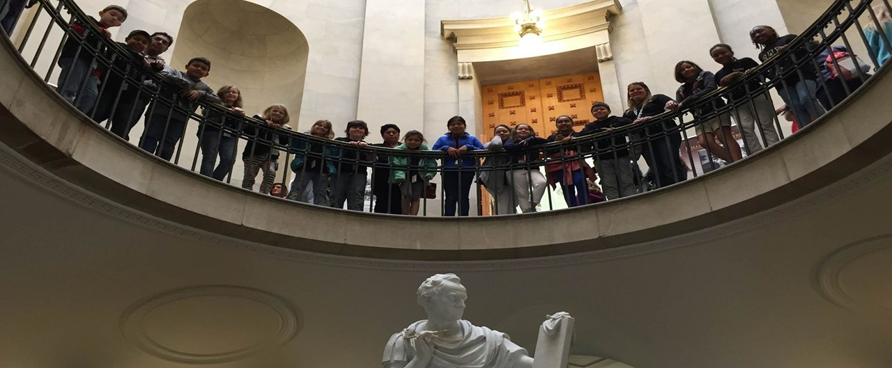 Grade 4 Field Trip to Raleigh group photo on stairway looking down