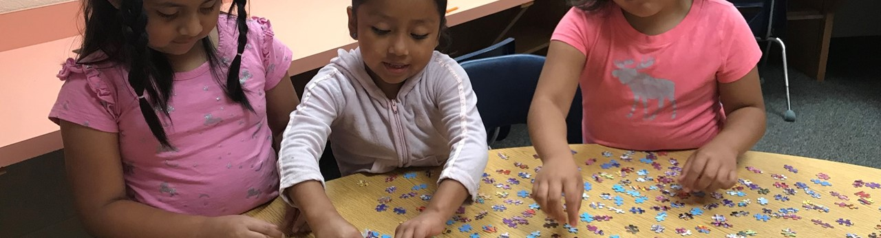 ESL Students working on puzzle