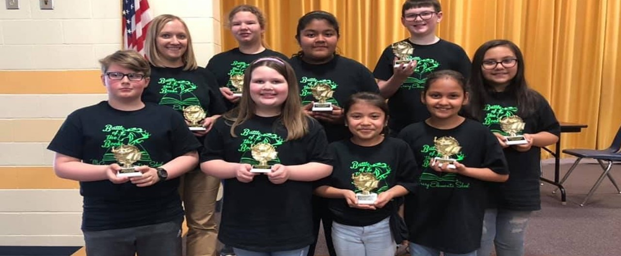 McCrary Battle of the Books Team - students holding trophies