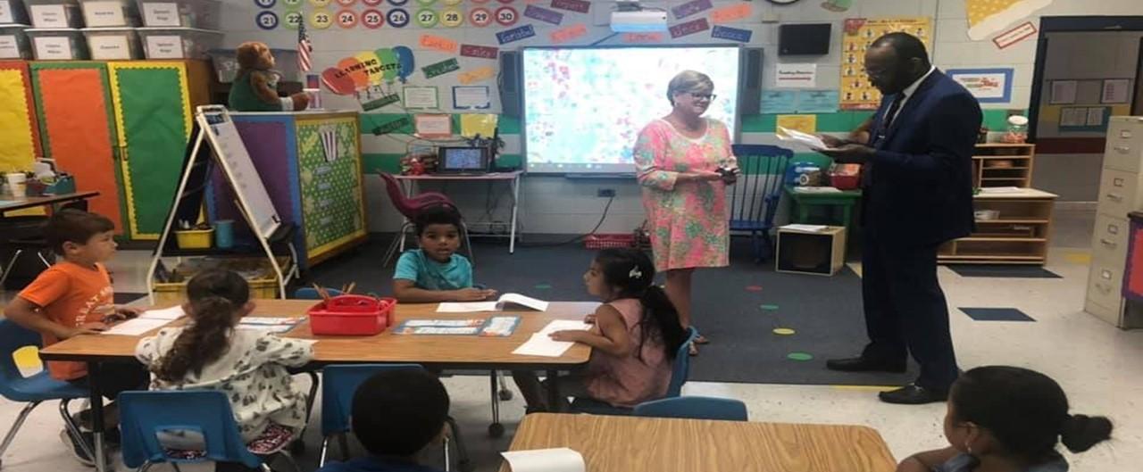 Kindergarten teacher Rebecca Kidd receives Fox8 Educator of the week award