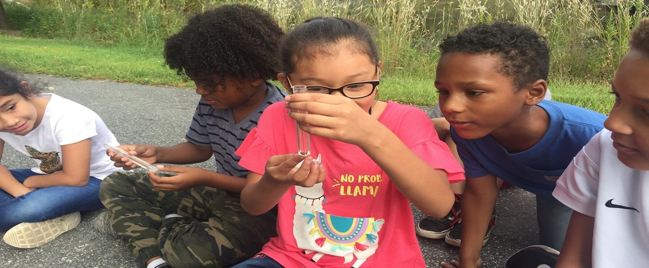Third graders testing water quality during science day at the NC Zoo