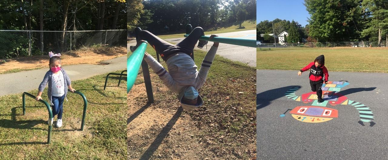 Three second graders enjoy the playground