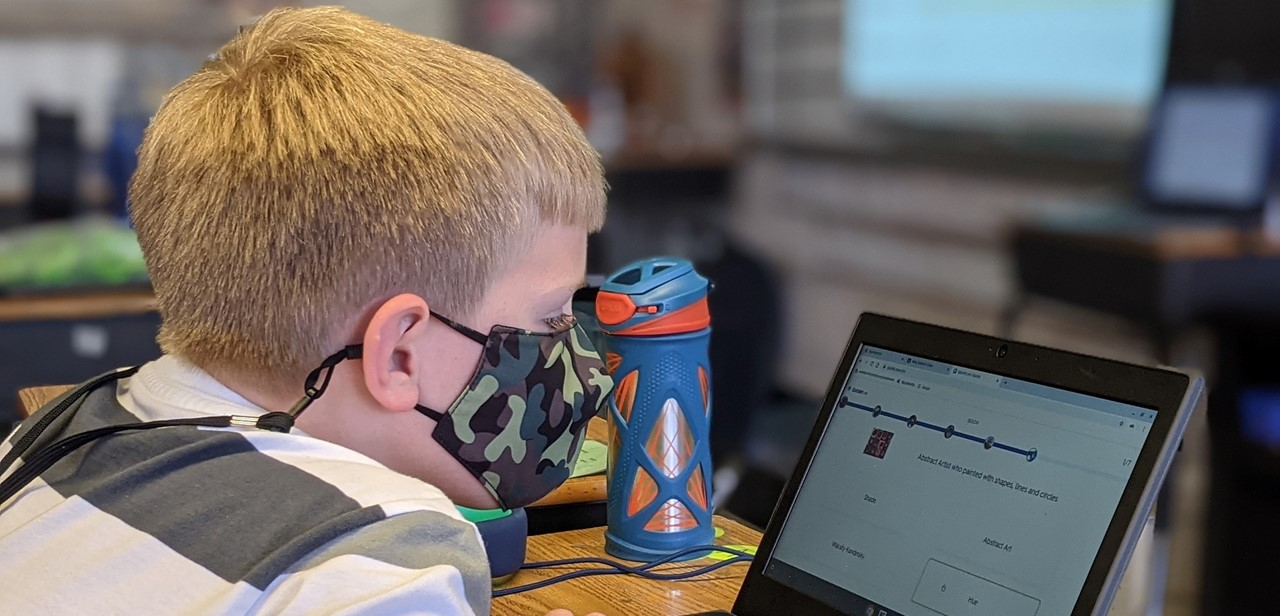 Student using Chromebook for in-person instruction