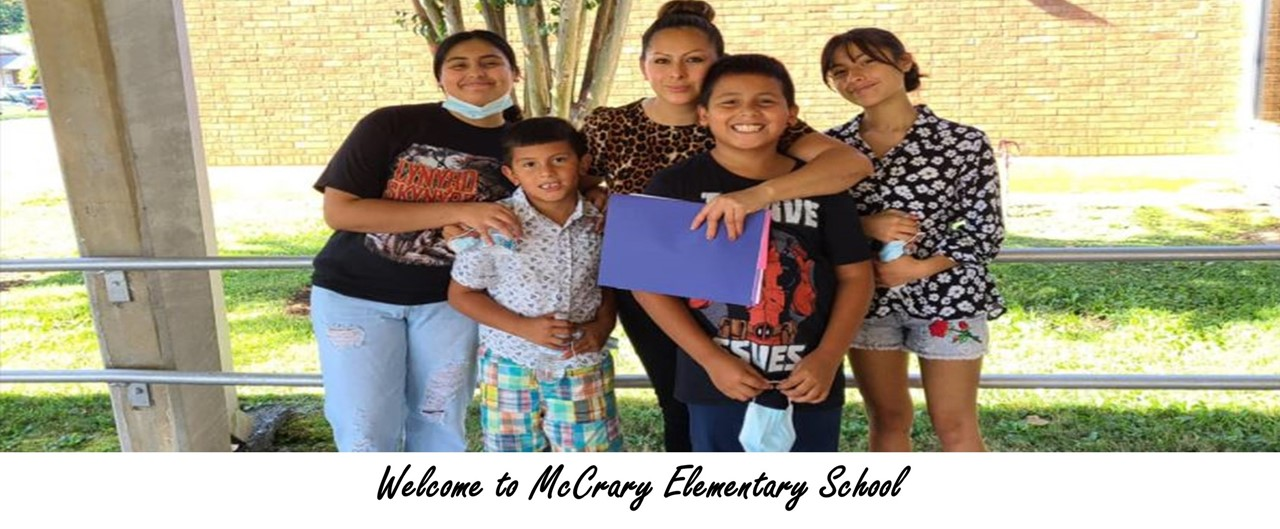 a family of five standing in front of the school for open house - welcome to mccrary elementary school
