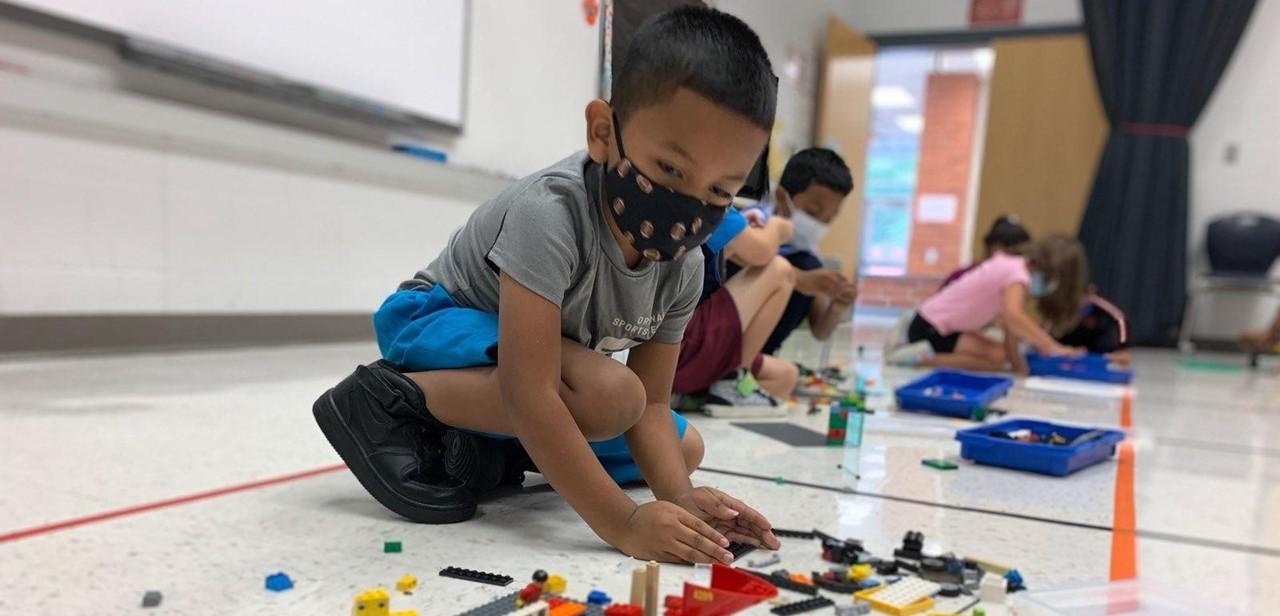 Kindergarten students explore STEM themes using lego kits
